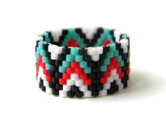 Beautiful wide boho ring. Ethnic style jewelry. This peyote ring made with Miyuki delica seed beads.  Band width - 15 mm Sizes - 8.5 (US)  More