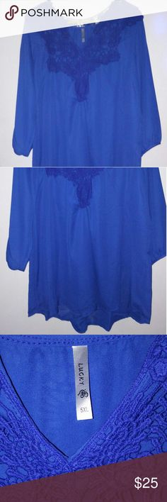 Beautiful Sheer Blouse Pretty shade of blue...this was purchased from Dresslilly for a friend who needed bigger girl sizes. Ordered her a 5XL...and when the package arrived all the shirts were listed and tagged as a 5XL...but clearly THEY ARE NOT!!! This fits ME...AND I WEAR A 16-18 or an XL....I cannot get ahold of anyone in the customer dept so i have no choice but to sell here. :(  Im going to list it as a 20..but tag says 5X. Tops Blouses