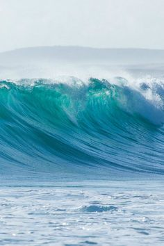 aqua blue waves - I love the lift when I watch a wave cresting, like it's inhaling before it exhales and drops down