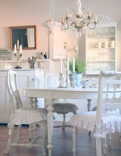Powder pink and white can brighten up any room. The chandelier is ...