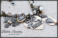 Torch soldered charms wrapped in pearls and bling.