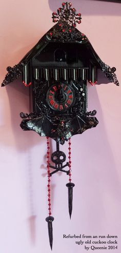 the Vampire Clock is a fun project i've been working on all week. another refurb of a cuckoo clock. i forgot to get a before though  trust me, it was a usual ugly brown clock. i used pieces that i had around the house and made the pendulum, chain and carved those tiny spikes. send me all your old clocks cause this is fun. haha