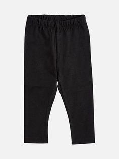 Pehmeät trikoot, joissa on kuminauha vyötärössä.  Musta