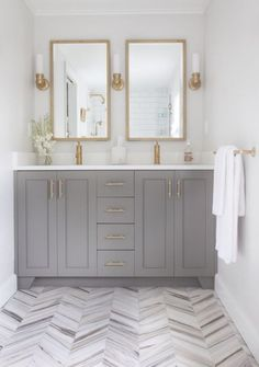grey and gold bathroom gorgeous double mirrors and sinks herringbone floor Source by cmlooking The post Grey & Gold: The Perfect Balance of Warm with Cool appeared first on Isadora Design. Gold Bathroom, Bathroom Renos, Bathroom Flooring, Master Bathroom, Bathroom Ideas, Bathroom Renovations, Bathroom Storage, Bathroom Canisters, Grey Paint For Bathroom