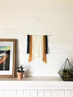 Small Modern Yarn Wall Hanging Tapestry   Bohemian Modern Style   Dorm Room Decor This one-of-a-kind small yarn wall hanging features a wood dowel rod with white, teal and gold yarn. The designer's wall hangings, wood signs, and other home decor products play with texture and layers while incorporating natural materials and pops of color to make a home your haven. Discover more boho fiber art at https://www.etsy.com/shop/7thStreetHaven