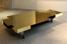 Available now in South Africa DC 1301 Irregularly shaped coffee table with polished brass top,...