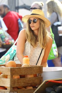Added extras: The 27-year-old, whose older sisters are twins Mary-Kate and Ashley Olsen, accessorized the look with a wide-brim straw hat and a stylish pair of sunglasses