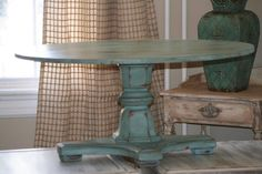 Provence and dark wax pedestal coffee table