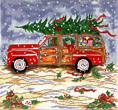 I love this red woody driving in the snow with the Christmas tree on top.