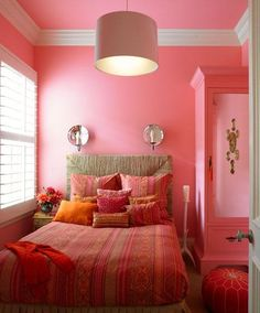 Love the white molding & blinds and also the pink armouir.