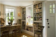 Updating a Small Cape from the 1820s in Vermont - built-in bookshelves surrounding a window, with ledge underneath the window for a place to sit a vase of flowers.  So pretty and functional.