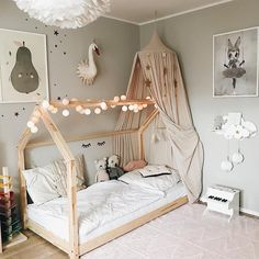 I love those wooden geometric bed structure. Especially with the lights wrap around the top beam. Really cool kid's room inspiration!