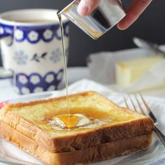 Hong Kong Style French Toast - what's not to love about a PB sandwich dipped in eggs and pan-fried then drizzled with maple syrup?