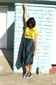 Ashley of Milk Teeths looking bad-ass in a vintage wool a-line skirt and a yellow tee.