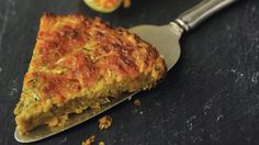 You don't have to worry about rolling out dough and dealing with cracks, breaks or a not-quite-right texture with this recipe. A mixture of shredded zucchini, eggs, chopped onions, baking mix (like Bisquick) and shredded Cheddar form the crust on their own.