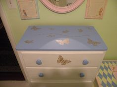 I like the butterfly theme of this dresser. My granddaughter suggested I add a butterfly to the center of each drawer, so I believe I will be stenciling a few more butterflies!