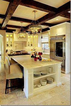 Love the dark beams above a creamy kitchen