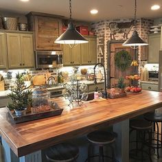 Love this look for the kitchen, just not the size. Too small for my huge family who loves to all be in the kitchen together..love it, except for the cabinet colors. I would do white or a light shade of gray