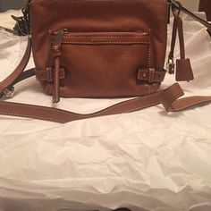 RARE!!!! NWOT Michael Kors Abby Crossbody This darling cross body from Michael Kors has the perfect details to make it feminine and fun.  You won't see this purse all over, it is rare!FEATURES:  Walnut Brown Leather Exterior  Silver Hardware  Exterior Zip Pocket  Lined Interior  2 interior pockets (1 open, 1 zip)   H 8 X W 11 X D 2 Michael Kors Bags Crossbody Bags