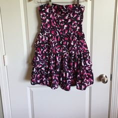 Strapless dress Shades of purple and pink ruffled skirt strapless dress. 24 inches total in length Dresses Strapless