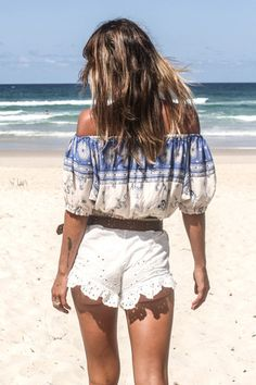 Coyote Off The Shoulder Top - Sky. A gorgeous cropped off the shoulder top in an original Spell print of hand drawn 'Wild West' inspired symbols in deep sky blues. Perfect paired with our Coyote Maxi skirt or thrown on with denim cut offs.