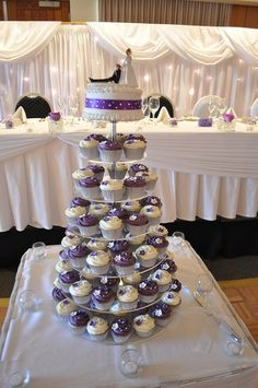 Purple and white wedding cupcakes by Cupcake Passion (Kate Jewell), via Flickr