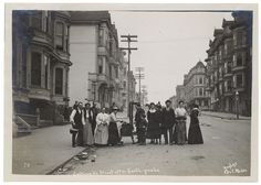 Photograph of group cooking on a stove in the street after the 1906 San Francisco earthquake