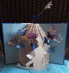 book sculpture boy with butterflies by mademeathens #booksculpture #alteredbook