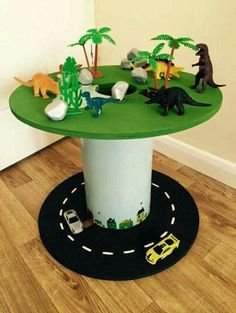 Would be cool in a dinosaur boy's room! Would be cool in a dinosaur boy's room! Diy For Kids, Crafts For Kids, Spool Tables, Small World Play, Wooden Spools, Wire Spool, Kids Bedroom, Boys Dinosaur Bedroom, Boy Room