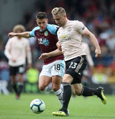 Luke Shaw of Manchester United in action with Ashley Westwood of Burnley during the Premier League match between Burnley FC and Manchester United at Turf Moor on September 2018 in Burnley, United. Burnley Fc, Premier League Matches, Manchester United, Action, The Unit, Sports, Hs Sports, Group Action, Man United
