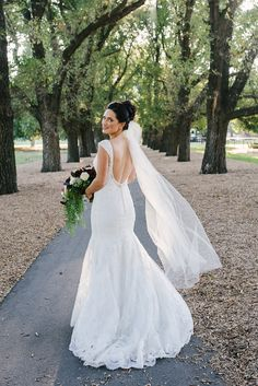 Modern cap sleeve lace wedding dress with low back and high bun with veil | Bec Matheson Photography