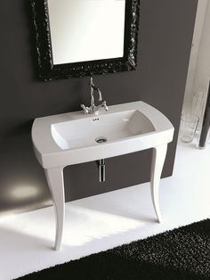 Curved legs of the washbasin evoke a classical appeal Trendy Bathroom Decor With An Art Deco Twist From Artceram