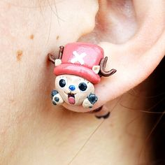 Give your look a little pirate flair when you attach the cutest pirate in One Piece to your ear. This Chopper stud is handmade from polymer clay to represent the toddler sized human jumping through your earlobe.#onepiece #chopper #kawaii #cute #anime