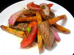 Peruvian Cuisine Week: Lomo Saltado (Chinese-Peruvian Beef Stir-Fry)  I  This fusion dish blends the traditional flavors of China (soy sauce, ginger) with the spicy peppers of Peru for a meal that is vibrant in both color and taste.   #AsianInspiration @Pisco Trail.com