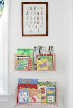 Wire baskets used in a nursery to hold books...genius!
