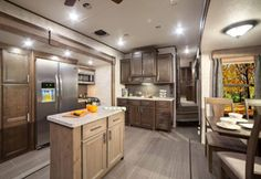 2017 RF348RLS Kitchen  The Roamer line of fifth wheels and travel trailers are designed with the seasoned traveler in mind. You'll find floorplans designed for extended use that maximize space while keeping weight to a minimum.   Learn more: https://www.highlandridgerv.com/products/2017/roamer/