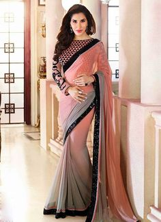 Chiffon saree adorned with patch border, teamed up with contrasting blouse.