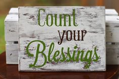 Distressed Wood Sign - 'Count Your Blessings'. $15.00, via Etsy.
