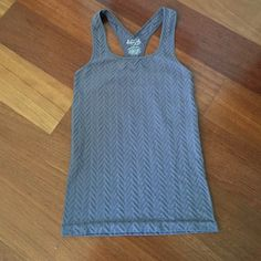 Free People tank top Free people tank top with cutouts in the back. Great for working out and everyday use! Hardly worn. Fits more like a small than a medium. Free People Tops Tank Tops