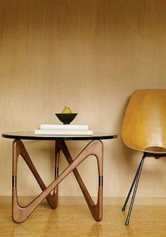 Moebius table from BODIE and FOU Material: Walnut stained beechwood base with brass connectors, 3/4 • Dimensions: Ø70 x H 51 cm • Flat-packed • Please allow 1 to 2 weeks for...