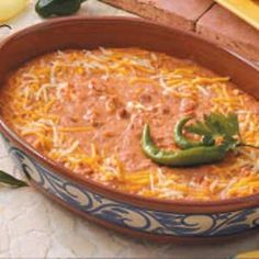 This is how we make this Cheesy Bean Dip: 2 cups shredded mozzarella cheese, 2 cups shredded cheddar (save 1 cup to sprinkle on top) 1 can refried beans, 1 cup sour cream, 8 oz cream cheese and 1 package mild taco seasoning, mix all together, sprinkle top with remaining cheddar, bake at 350 for about 30min, serve with tortilla chips