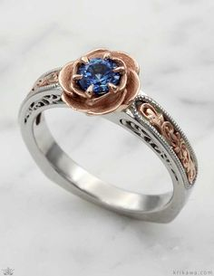 Vintage Scrollwork Rose Engagement Ring, pictured in platinum with 14k rose gold scrollwork and rose. Customize this design in the metals and solitaire stone you want!