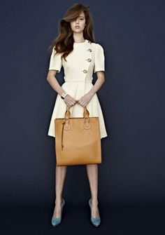 Karlee (Chic) wears Prada dress, Tiffany & Co. bangles and sass shoes.  Chloe bag donated by David Jones.