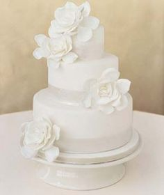 Love it...1 layer with just the ribbon and a flower...ribbon could be a light pink to match centerpiece flowers or the purple of the bridesmaids dresses