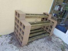 firewood storage table concrete block backyard potting bench