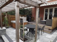 Toronto landscaping - backyard patio, deck using composite materials. hot-tub and trellis features.