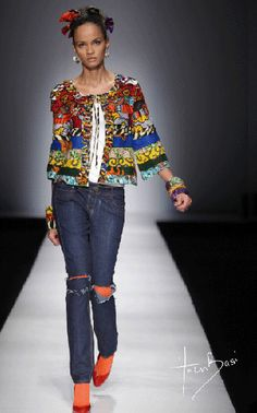 Nigerian fashion designer Ituen Basi. An eclectic mix of styles, colors, and inspiration drawn from the Nigerian market.