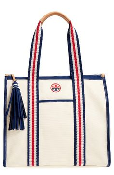 Free shipping and returns on Tory Burch Preppy Canvas Tote at Nordstrom.com. Ropy nautical trim and straps add to the fun, preppy look of a sturdy cotton-canvas tote detailed with two-tone logo embroidery and a swishy tassel that does double duty as a zip pull.