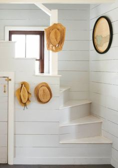 Painted shiplap stairwell in a restored Bahamas beach cottage on Harbour Island. Coastalliving.com