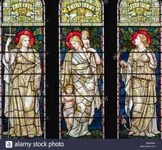 Faith, Hope and Charity in stained glass by Henry Holiday in the 'Church of St. Mary The Virgin', Kirkby Lonsdale, Cumbria, UK Stock Photo